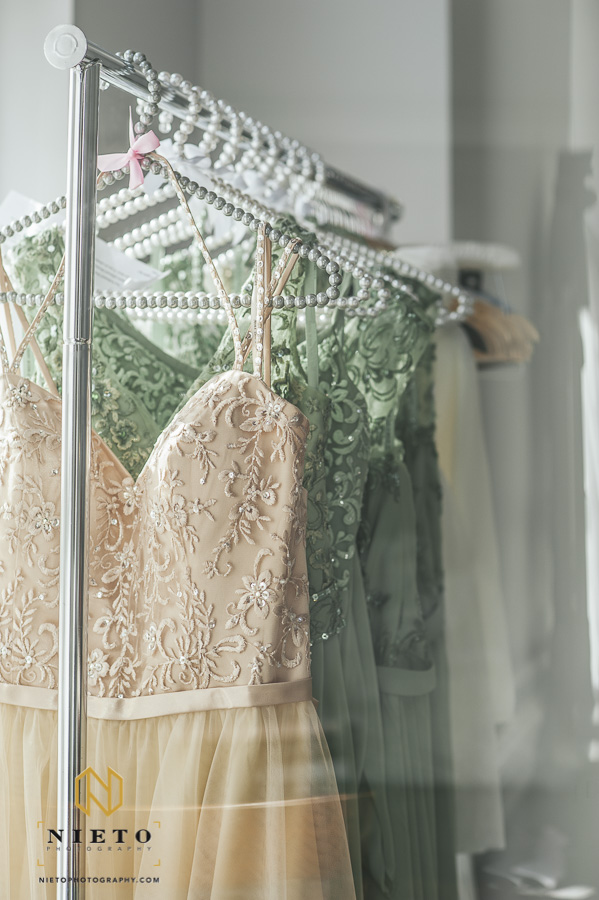 the bridesmaids dresses hanging on pearl hangers