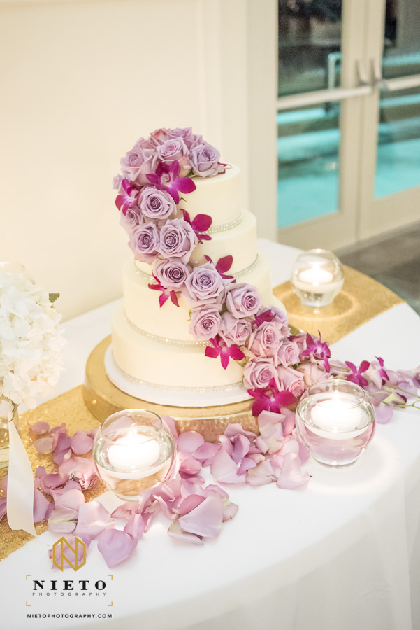 purple roses cascading down a wedding cake at Park Alumni Center at NC State