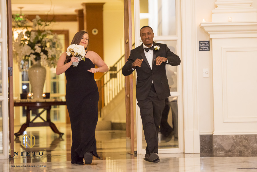 maid of honor and best man dancing while they are being introduced into the reception at Park Alumni Center