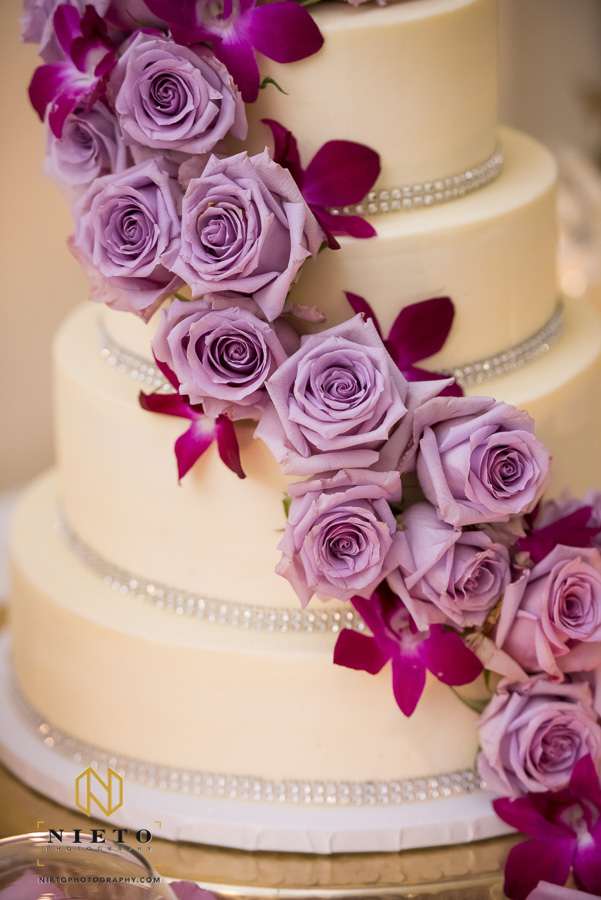 purple flowers cascading down the wedding cake
