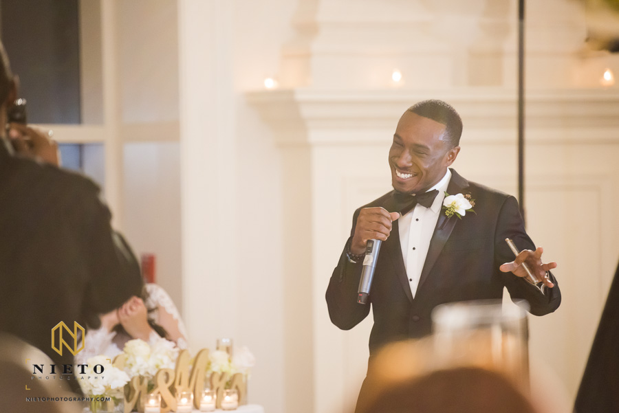 the best man laughing as he gives the wedding toast