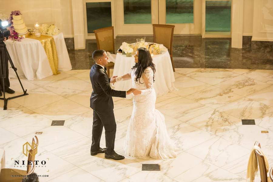 balcony shot of bride and groom dancing together