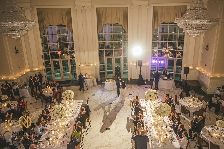 balcony shot of bride and groom as they dance at their Park Alumni Center wedding reception