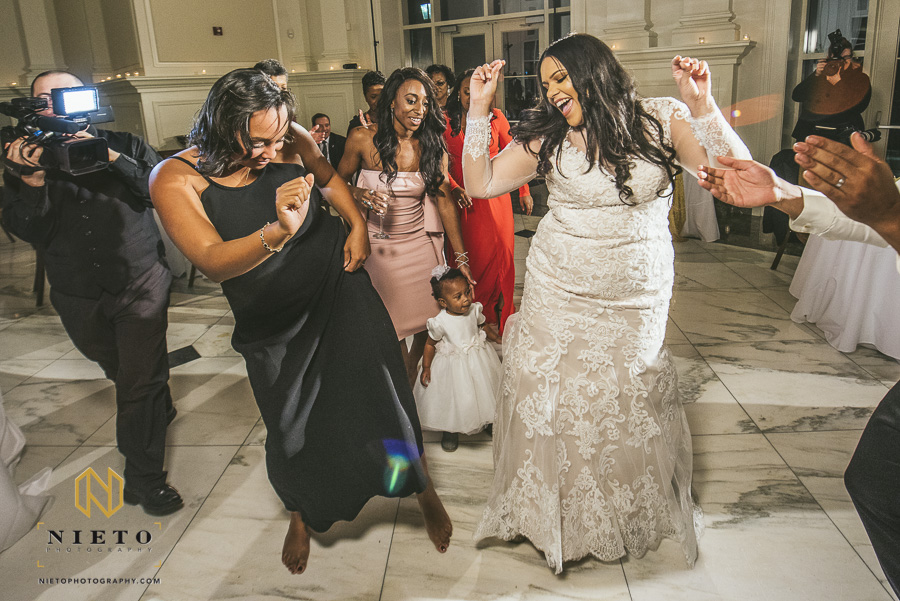 bride and guest dancing with flower girl and Park Alumni Center