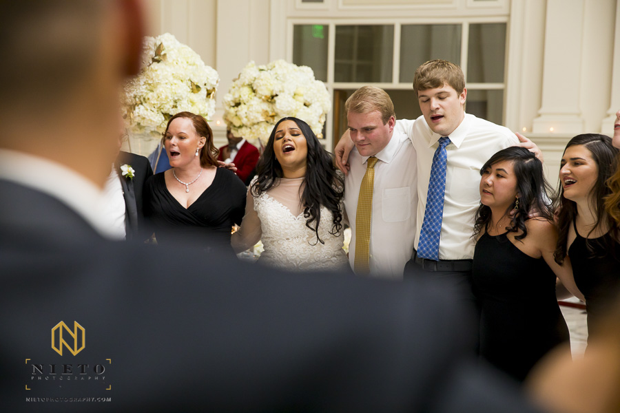bride singing with her mom and guest during her Park Alumni Center wedding reception