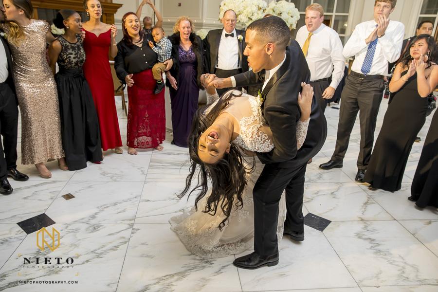 groom dipping his bride during their Park Alumni center wedding reception