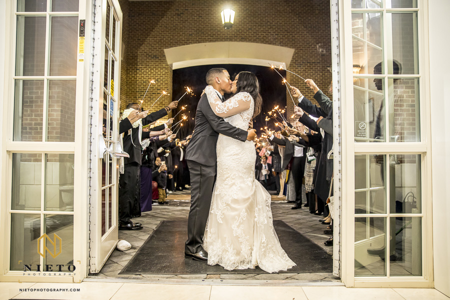 bride and groom kissing before walking out of the Park Alumni Center for their sparkler exit
