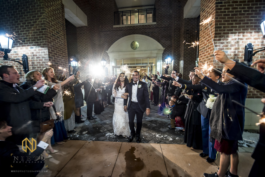 bride and groom walking out of the Park Alumni Center for their sparkler exit