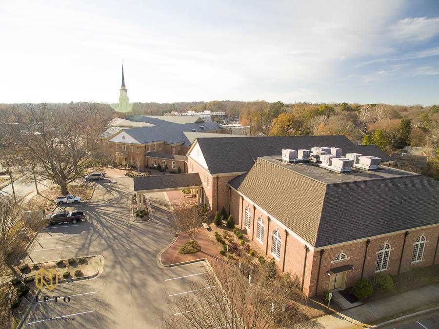 drone shot of Hayes Barton Baptist Church in the afternoon