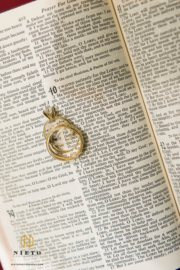 Wedding rings sitting on the Bible on Psalms chapter 40 verse 3