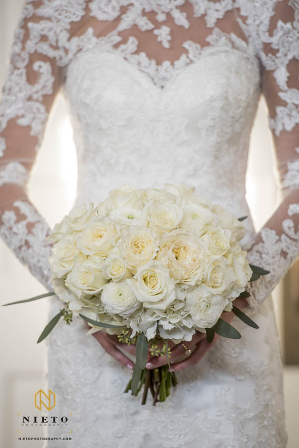 close up of the bride holding her bouquet in front of her dress