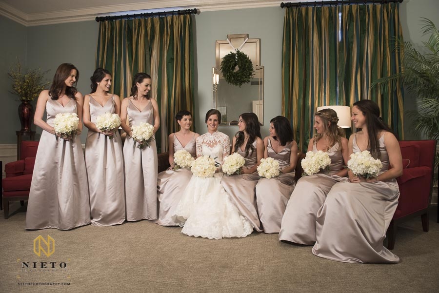 bridesmaids looking at the bride in the parlor at Hayes Barton Baptist Church