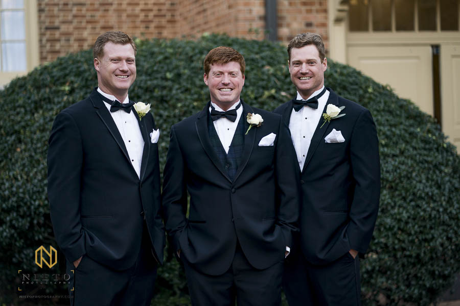 groom posing with his brothers during formal portraits at Hayes Barton Baptist