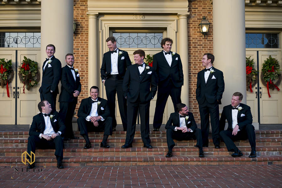 groomsmen sitting on the steps of Hayes Barton Baptist Church
