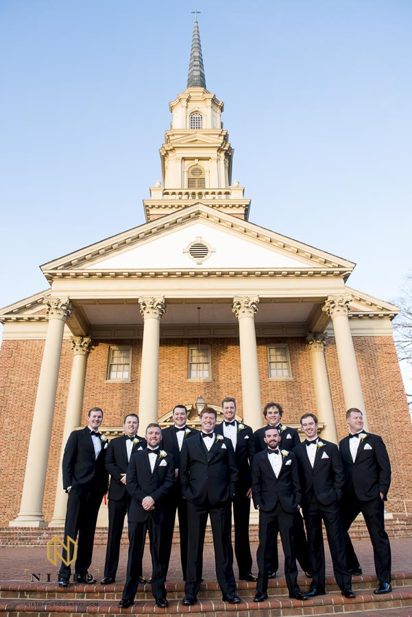 Groom and his groomsmen posing outside Hayes Barton Baptist Church