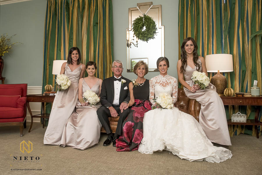 Bride with her family posing for a portrait before her Hayes Barton Baptist Church wedding