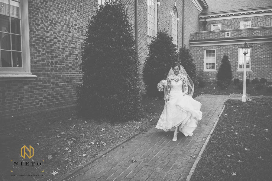 Bride running to get to the front of the church