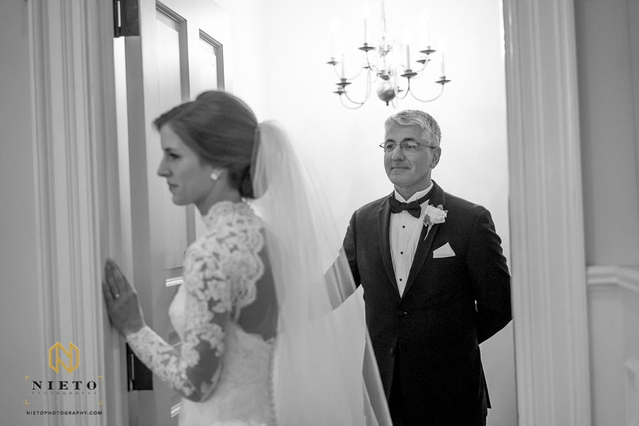 the father of the bride watching his daughter before her ceremony