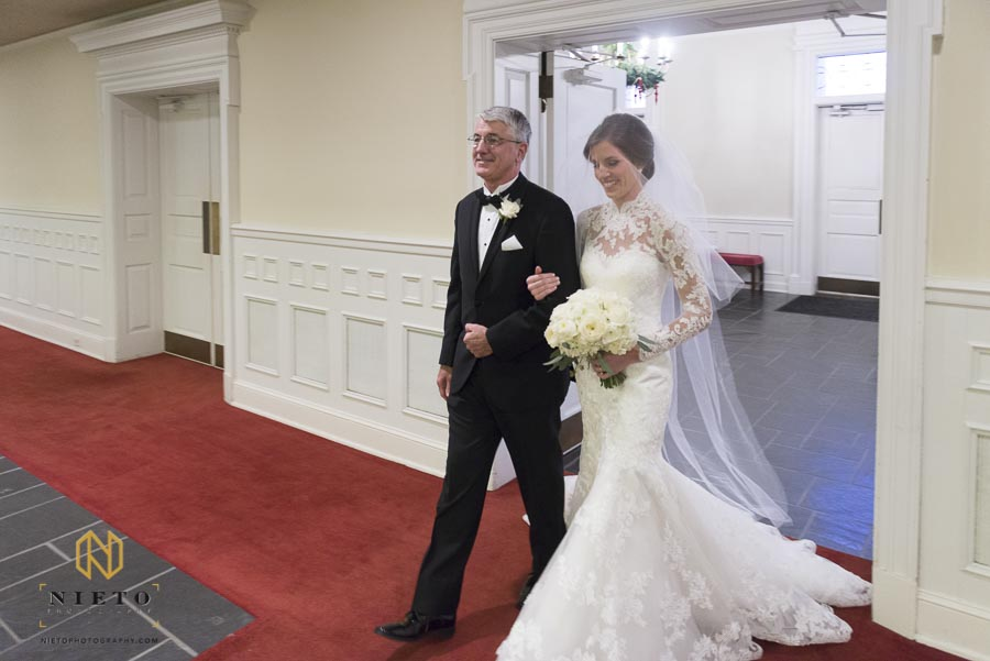 father escorting his daughter down the aisle for her Hayes Barton Baptist Church wedding