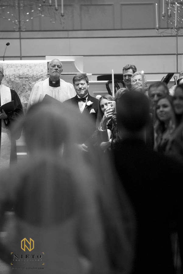 groom seeing his bride for the first time walking down the aisle at Hays Barton Baptist Church