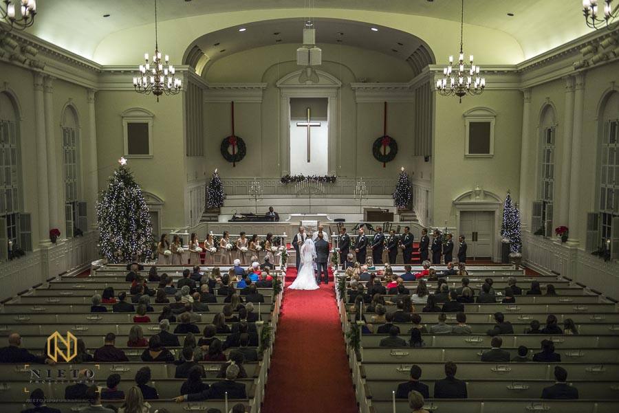 wide shot of the wedding ceremony at Hayes Barton Church