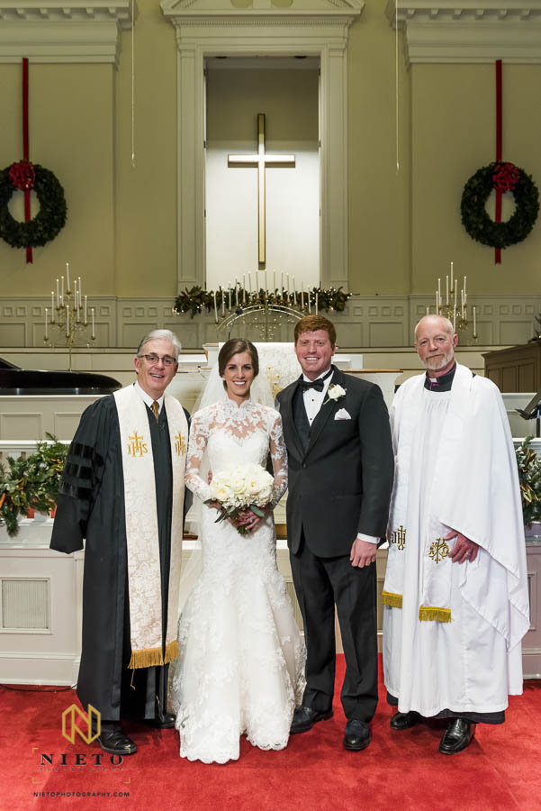 bride and groom posing with the wedding officiants at Hayes Barton Baptist Church
