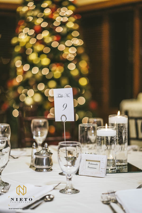 table number with Christmas tree in the background