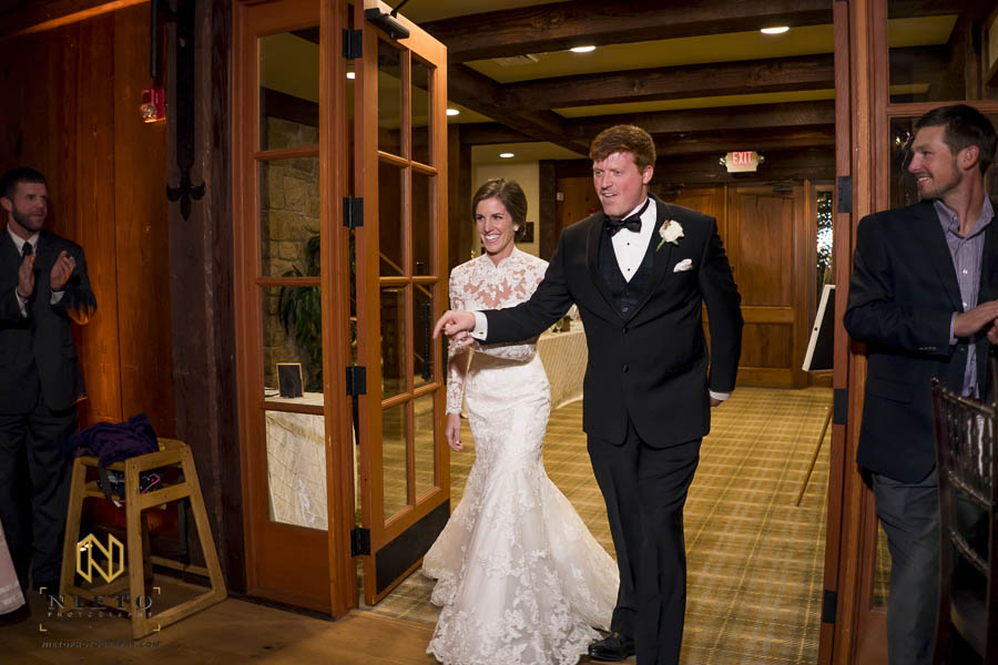 Bride and groom make their entrance to their MacGregor Downs Country Club Reception