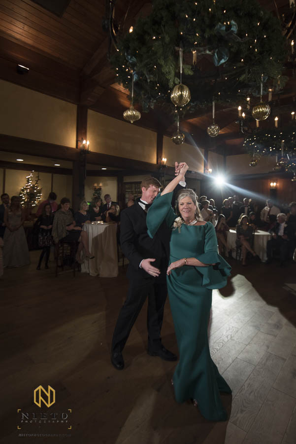 groom twirling his mother during the Mother Son dance at MacGregor Downs Country Club