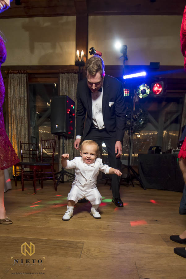 ring bearer dances during MacGregor Downs wedding reception