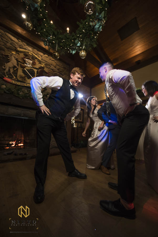 groom dances with guest to Lean Back during the reception at MacGregor Downs