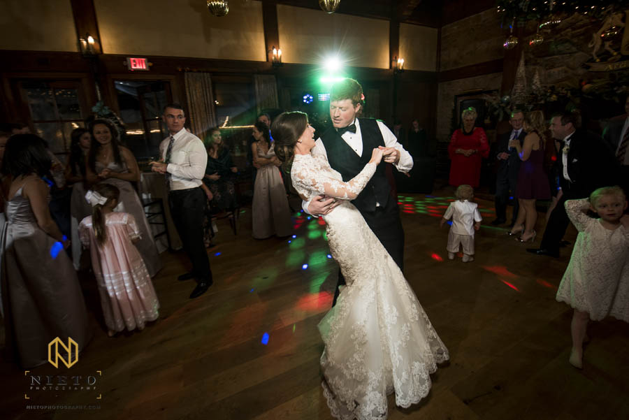 groom dips the bride during their MacGregor Downs wedding reception
