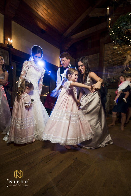 flower girl dancing with bridesmaid at MacGregor Downs wedding reception