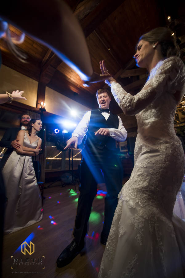 bride and groom dance with their guest at MacGregor Downs Country Club