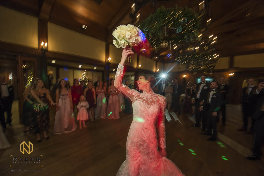 Bride tosses the bouquet over her shoulder at her MacGregor Downs Country Club wedding reception