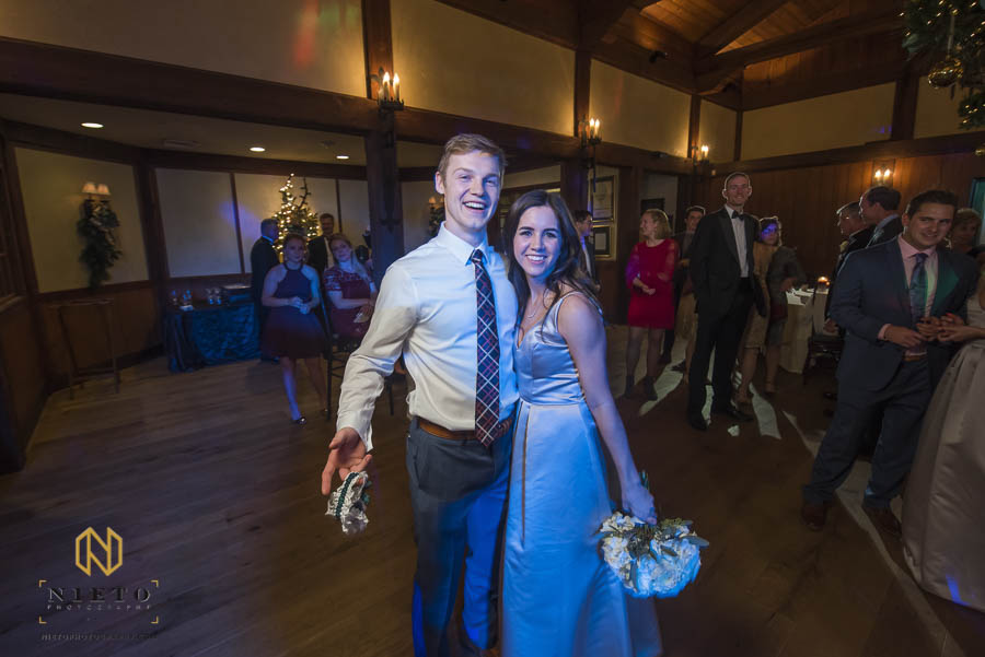 couple who caught the garter and bouquet pose together for portrait
