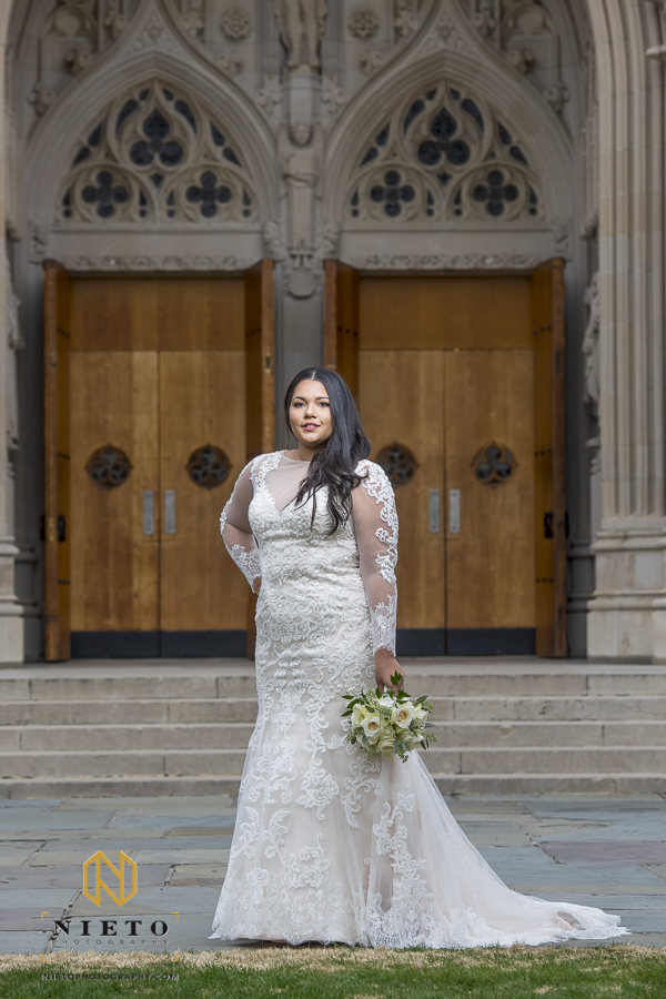 bride smiling for her bridal portraits in front of Duke Chapel