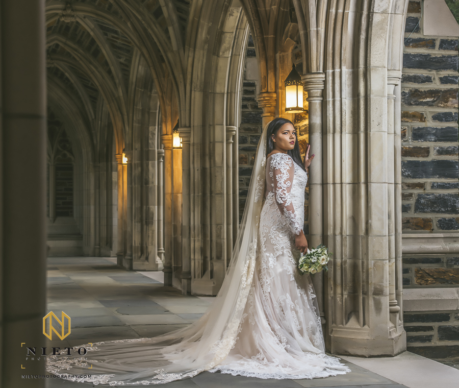 bride leaning against a column looking over her shoulder Duke Chapel