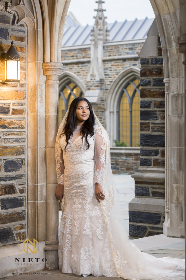 bride standing in a n elegantly detailed wedding gown for her Duke Chapel bridal portrait