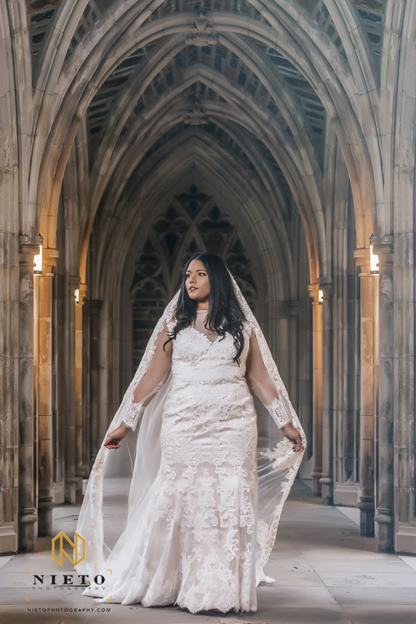 bride walking holding her veil at her Duke Chapel bridal session