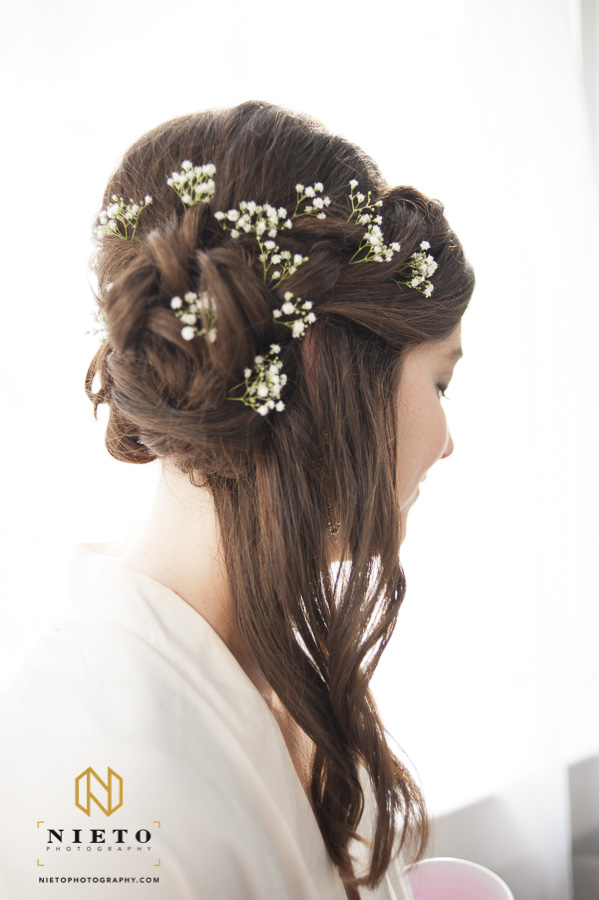 a bridesmaid with her done and flowers placed through out her hair