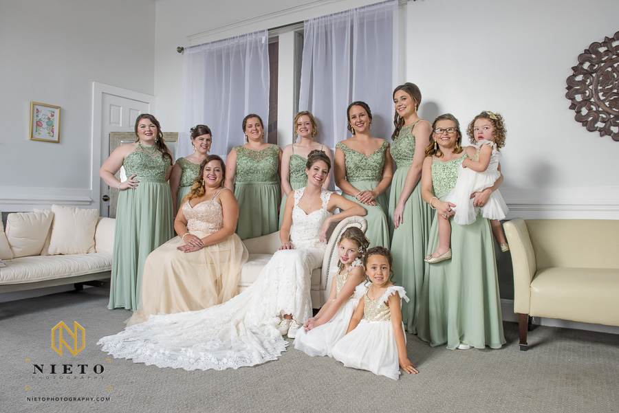 bride and her bridesmaids posing for formal portrait in the bridal suite at Market Hall