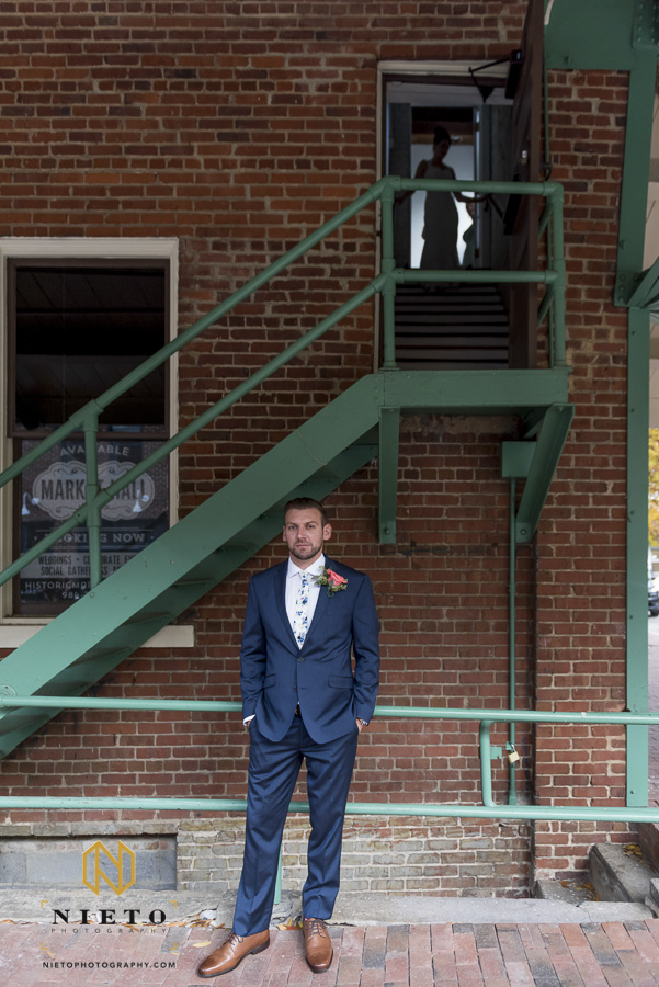 bride and groom have a first look at their Historic Market Hall wedding