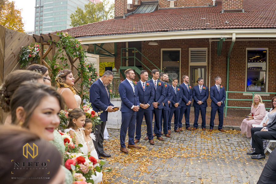 side view of the groom and groomsmen at the altar waiting for the bride to come down the aisle