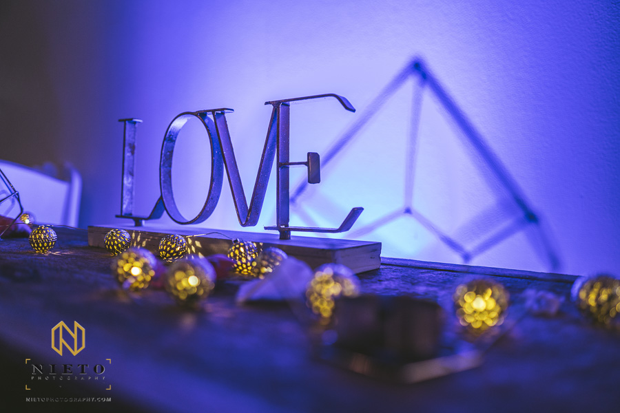 detail shot of a metal LOVE sign at a Market Hall wedding