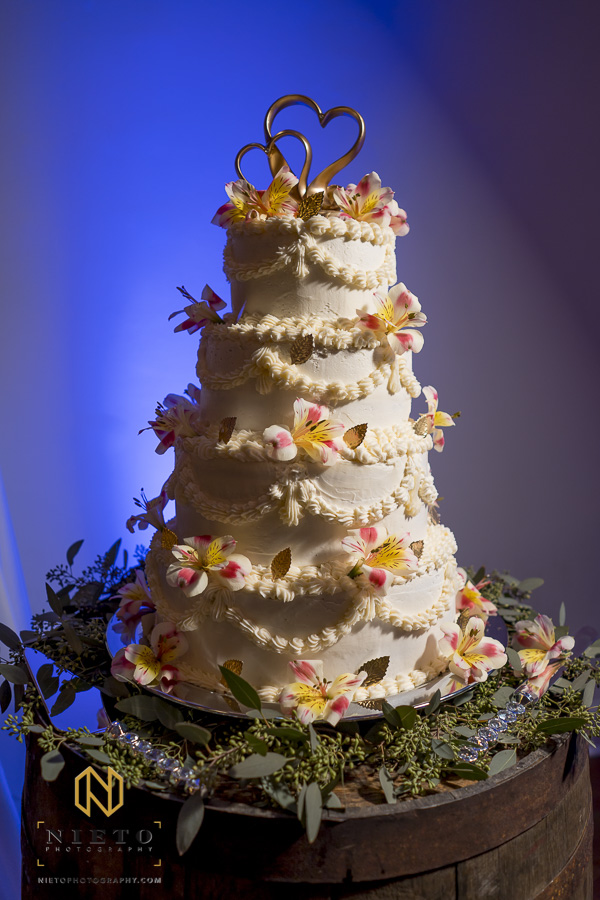 wedding cake at Market Hall with blue light bathing the wall behind it