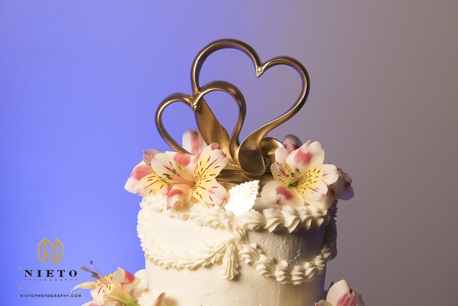 a gold two heart cake topper