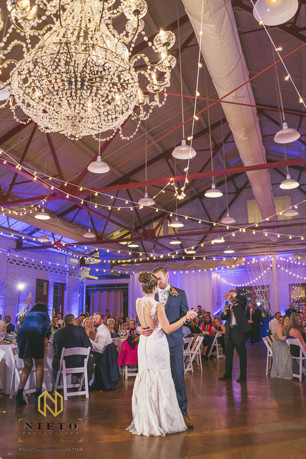 bride and groom dancing together during their Market Hall wedding