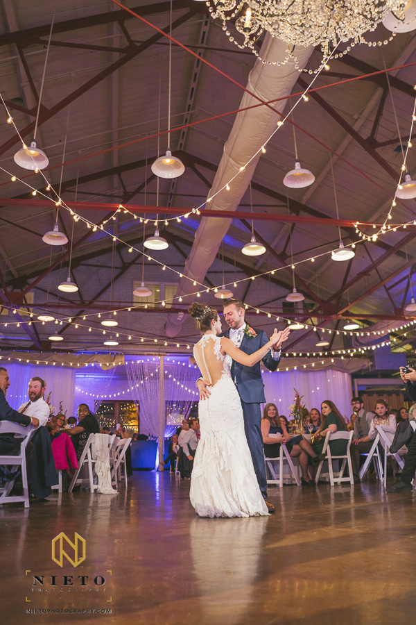 bride and groom dancing under the string lights at Market Hall