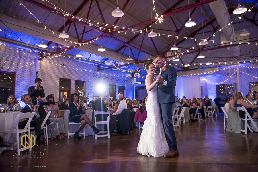 bride and groom dancing together at their Market Hall wedding reception